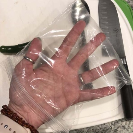 Protect your hand with a baggie.