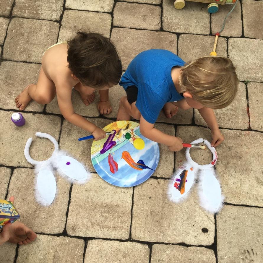 toddlers painting bunny ears