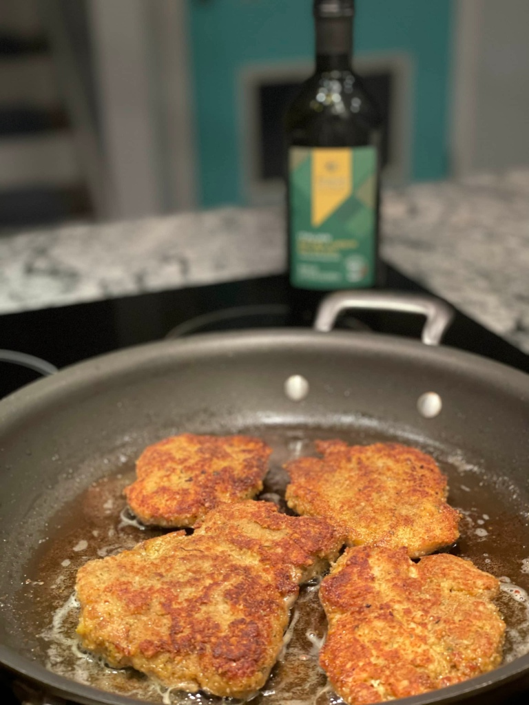 Pan frying chicken thighs in olive oil