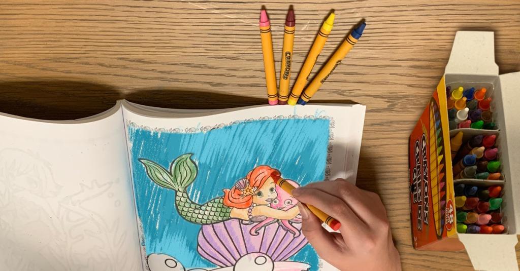 Child coloring mermaid